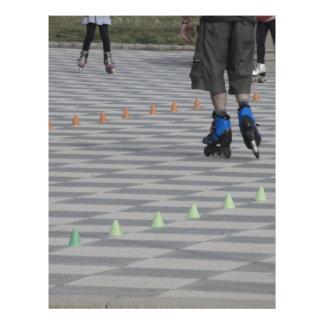 Legs of guy on inline skates . Inline skaters Letterhead