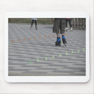Legs of guy on inline skates . Inline skaters Mouse Pad
