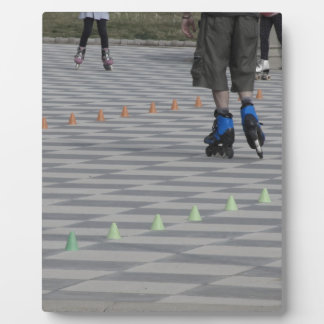 Legs of guy on inline skates . Inline skaters Photo Plaques