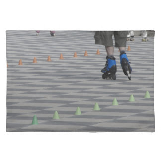 Legs of guy on inline skates . Inline skaters Placemat