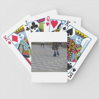 Legs of guy on inline skates . Inline skaters Poker Deck