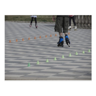 Legs of guy on inline skates . Inline skaters Postcard