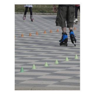 Legs of guy on inline skates . Inline skaters Postcard