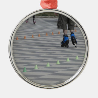Legs of guy on inline skates . Inline skaters Silver-Colored Round Ornament