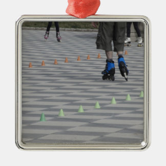 Legs of guy on inline skates . Inline skaters Silver-Colored Square Ornament