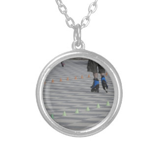 Legs of guy on inline skates . Inline skaters Silver Plated Necklace