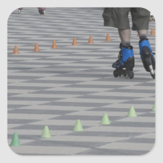 Legs of guy on inline skates . Inline skaters Square Sticker