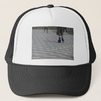Legs of guy on inline skates . Inline skaters Trucker Hat