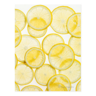 Lemon slices arranged in pattern backlit postcard