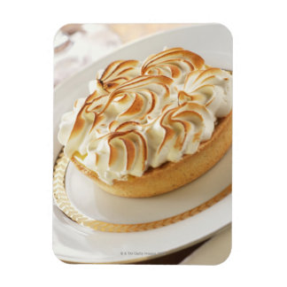 Lemon tart with baked meringue on plate magnet