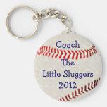 L'entraîneur d'équipe de baseball le porte-clé rond