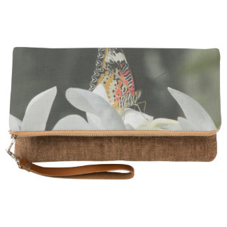 Leopard Lacewing Butterfly on White Orchid Clutch