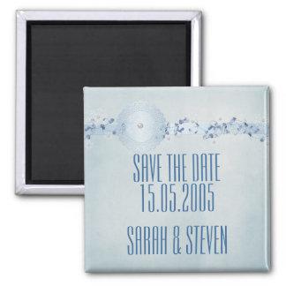 Les perles bleues de flocons de neige d'hiver font aimants pour réfrigérateur