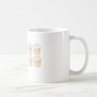 Les petits gâteaux avec arrose tasse à café