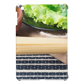 Lettuce in a black plate, pasta in a wooden bowl iPad mini cover