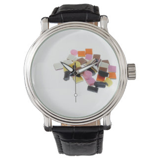 Licorice candy with copy space wrist watch