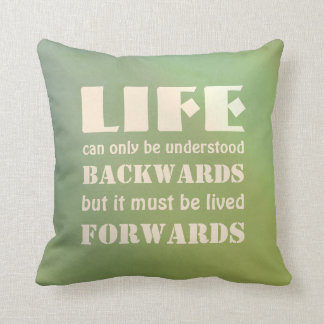 Life can only be understood backwards... throw pillow
