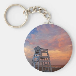Lifeguard chair with dramatic sky. basic round button keychain
