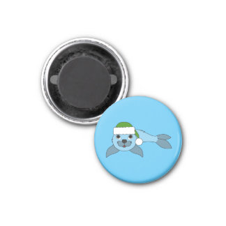 Light Blue Baby Seal with Green Santa Hat 1 Inch Round Magnet