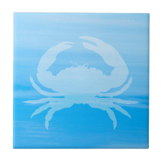 Light blue sea water with crab tile