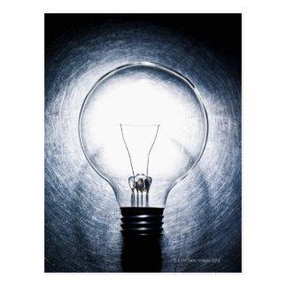 Light Bulb on Stainless Steel Background Postcard