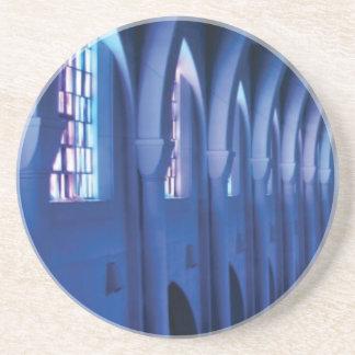 light enters dark church coaster
