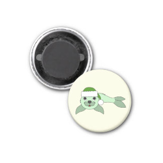 Light Green Baby Seal with Green Santa Hat 1 Inch Round Magnet