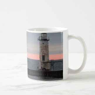 Light house and sunset view coffee mug
