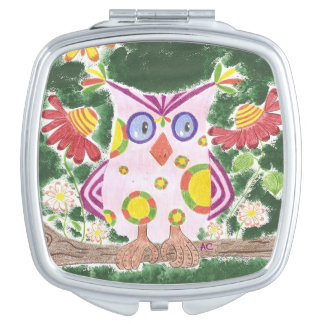 Light pink owl w/green background compact mirror