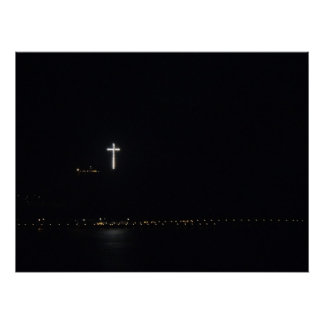 Lighted Cross over the Ocean at Night Poster