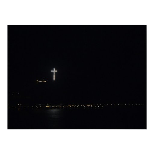 Lighted Cross over the Ocean at Night Posters