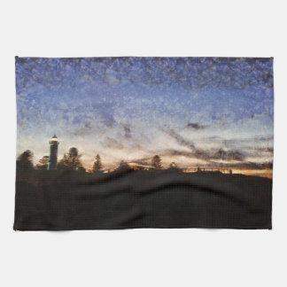 Lighthouse at sunset kitchen towel