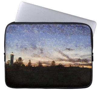 Lighthouse at sunset laptop sleeve