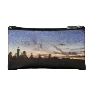 Lighthouse at sunset makeup bag