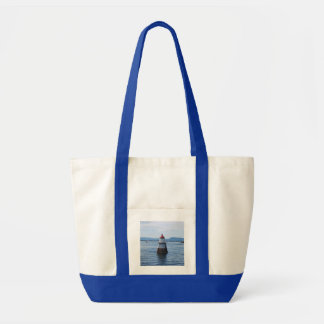 lighthouse in the sea tote bag