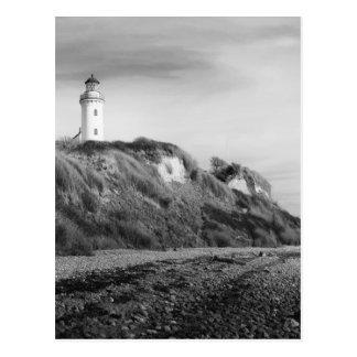 Lighthouse on beach postcard