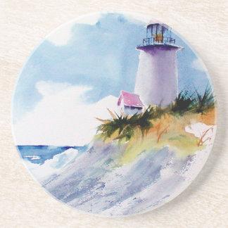 Lighthouse on sandy beach coaster