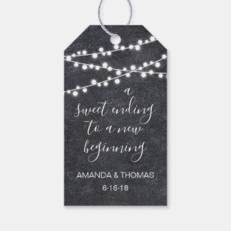 Lights garland on rustic blackboard favor hang tag