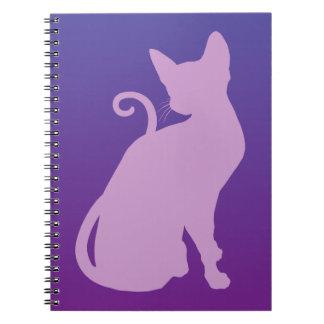 Lilac Cat on Purple Notebooks