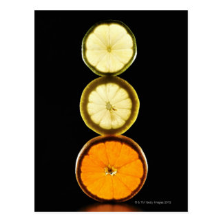 Lime,Grapefruit,Lemon,Fruit,Black background Postcard