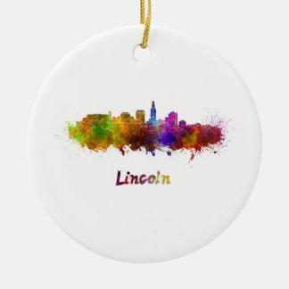Lincoln skyline in watercolor round ceramic ornament