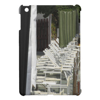 Line of closed beach chairs and umbrellas iPad mini covers