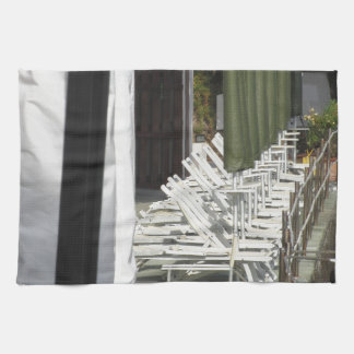 Line of closed beach chairs and umbrellas towel