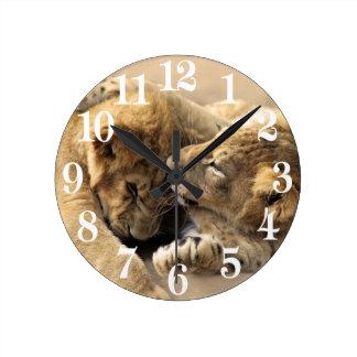 Lion cubs best friends round clock