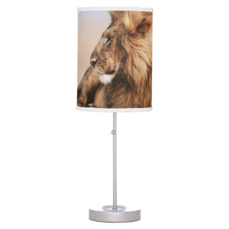 Lion resting in grass table lamp