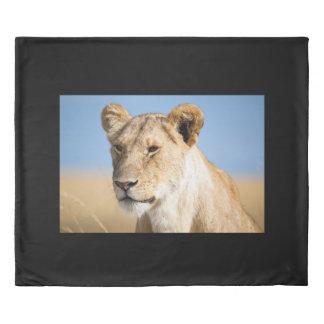 Lioness against blue sky duvet cover