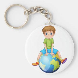 Little boy sitting on blue planet basic round button keychain