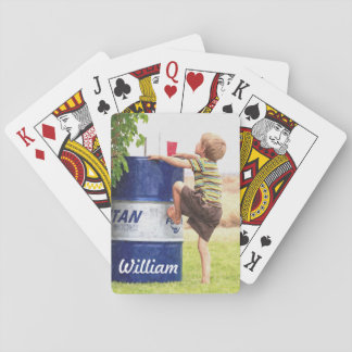 Little boy with plan playing cards