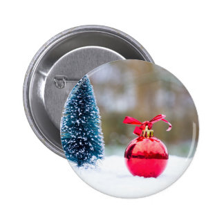 Little christmas tree and red bauble in snow 2 inch round button