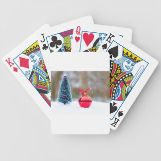 Little christmas tree and red bauble in snow bicycle playing cards